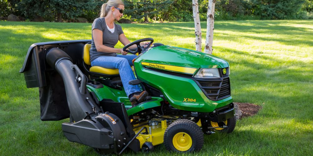 Lawn tractor with a bag attachment to collect grass clippings.